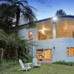 Emerald Art Deco home with sprawling grounds a true treasure